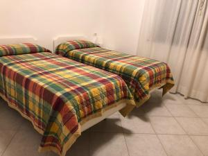 A bed or beds in a room at Residence Capo Nord