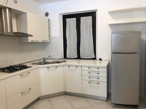 A kitchen or kitchenette at Residence Capo Nord