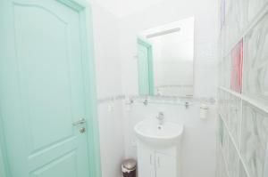Ванная комната в Апартаменты Алекс