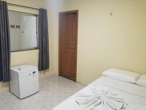 Кровать или кровати в номере Pousada Recanto do Sal