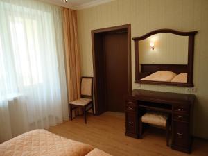 Кровать или кровати в номере Апарт-отель Куркино
