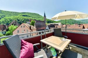 A balcony or terrace at Flair Hotel Vier Jahreszeiten