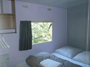 Un ou plusieurs lits dans un hébergement de l'établissement Camping des Catoyes
