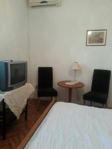 A television and/or entertainment centre at Family House Lise