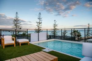 The swimming pool at or near The Sebel Brisbane Margate Beach