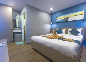 A bed or beds in a room at Sara Resort