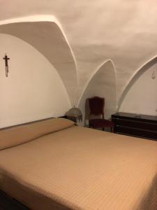 Letto o letti in una camera di Casa Camilla e Alberto