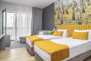 A bed or beds in a room at Notera Hotel SPA