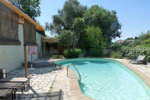 The swimming pool at or near Castel Enchanté