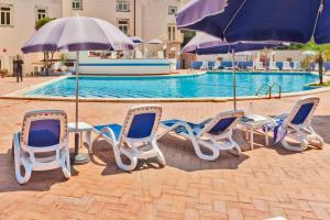 The swimming pool at or near Grand Hotel Villa Politi