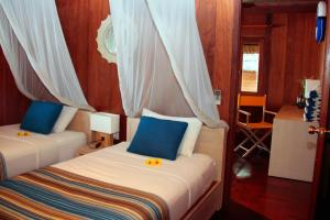 A bed or beds in a room at Coco Beach Resort