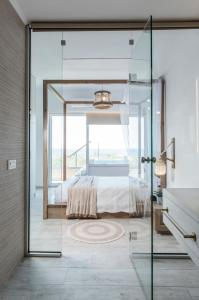 A bed or beds in a room at Kallia Luxury private