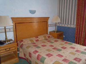 Un ou plusieurs lits dans un hébergement de l'établissement La Croix Blanche