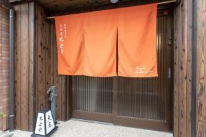 京町家 ちよせにあるテレビまたはエンターテインメントセンター