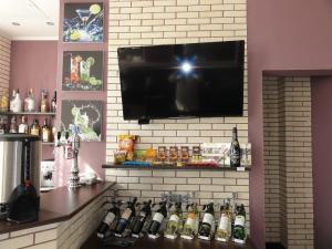 Телевизор и/или развлекательный центр в Dom otdykha Zhemchuzhina