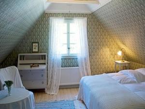 Säng eller sängar i ett rum på Vildrosor & Höns