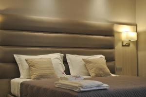 Letto o letti in una camera di Alludo Aparthotel b&b