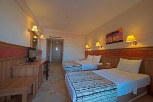 Кровать или кровати в номере Green Nature Resort and Spa