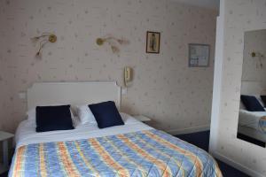 Un ou plusieurs lits dans un hébergement de l'établissement Hotel Restaurant Des Bains