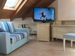 A television and/or entertainment center at Hotel Souvenir