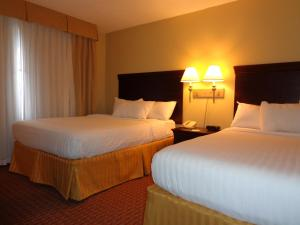 A bed or beds in a room at Euro-Suites Hotel
