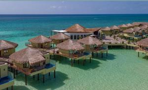 A bird's-eye view of Palafitos Overwater Bungalows at El Dorado Maroma, Gourmet All Inclusive by Karisma - Adults Only
