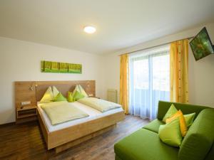 Ein Bett oder Betten in einem Zimmer der Unterkunft Haus Rainer