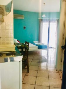 A kitchen or kitchenette at Contaratos Holiday Lettings