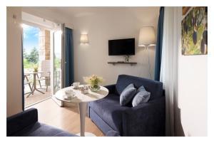 Predel za sedenje v nastanitvi Olive Suites - Hotel & Resort Adria Ankaran