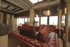 Uma área de estar em Niyaf Hotel Appartments
