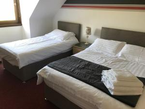 A bed or beds in a room at The Barn Lodge