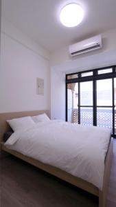 A bed or beds in a room at 810 Kinmen
