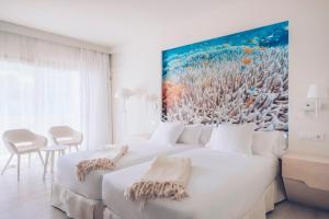 Cama o camas de una habitación en Iberostar Selection Fuerteventura Palace