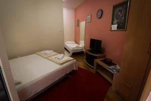 Кровать или кровати в номере Apartment Kralj
