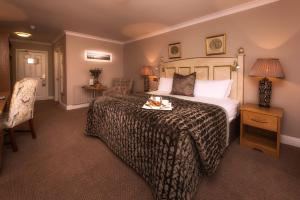 A bed or beds in a room at The Inn at Dromoland