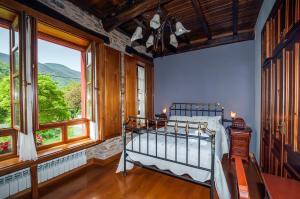 A bed or beds in a room at El Capricho de Josana