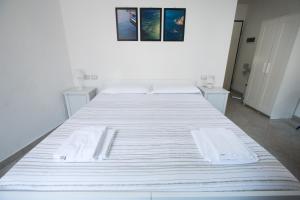 Cama ou camas em um quarto em Martinei