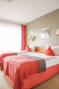 Кровать или кровати в номере Hotel Quellenhof