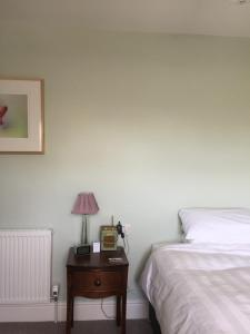 A bed or beds in a room at The Windsor Guest House