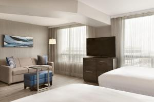 A television and/or entertainment center at Embassy Suites By Hilton Montreal Airport