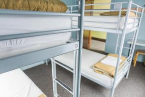 A bunk bed or bunk beds in a room at HI - Seattle Hostel at the American Hotel