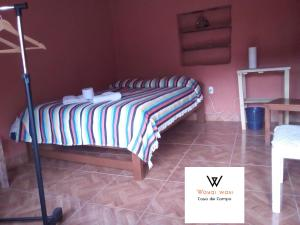 A bed or beds in a room at Wayqi Wasi