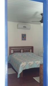 A bed or beds in a room at Pousada Ypê Amarelo