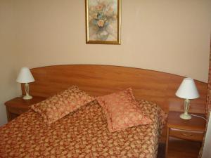Кровать или кровати в номере Отель Vicont