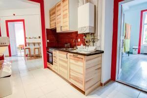 A kitchen or kitchenette at Pal's Mini Hostel