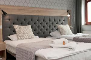 Łóżko lub łóżka w pokoju w obiekcie Apartamenty Stary Port