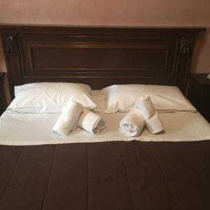 A bed or beds in a room at Residenza D'Epoca San Jacopo