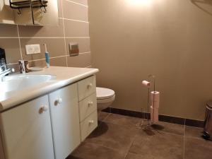 Koupelna v ubytování Chambre Chaleureuse chez l'habitant