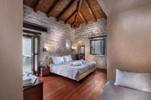 A bed or beds in a room at Petra & Fos Boutique Hotel & Spa