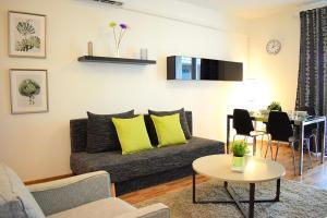 Zona de estar de Corvin Center Suites